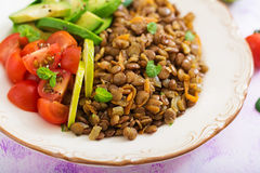 Diet menu. Healthy lifestyle. Lentils porridge and fresh vegetables - tomatoes and avocado Stock Images