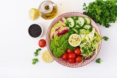 Diet menu. Healthy lifestyle. Vegan salad of fresh vegetables - tomatoes, cucumber, watermelon radish and avocado on bowl. Stock Photography
