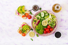 Diet menu. Healthy lifestyle. Vegan salad of fresh vegetables - tomatoes, cucumber, watermelon radish and avocado Stock Photo