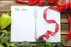 Diet menu on paper with vegetables royalty free stock images