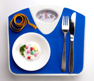 Diet menu on scale Royalty Free Stock Photos