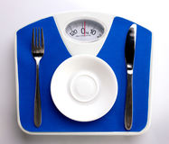 Diet menu on scale Royalty Free Stock Photo