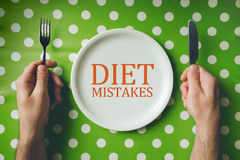 Diet mistakes concept, top view of dinning table Stock Photos