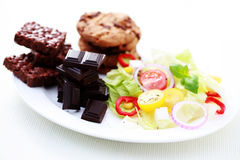 Diet or not. Plate full of salad and sweet food - diet and breakfast Royalty Free Stock Photos