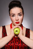 Diet or not. Attractive plus-size woman of middle age with green apple in hands Stock Photos