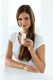 Diet Nutrition. Beautiful Smiling Woman Drinking Yoghurt Indoors. Diet Nutrition. Closeup Portrait Of Beautiful Smiling Young Woman Holding Bottle Of Drinking stock image