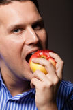 Diet nutrition. Happy man biting apple fruit Royalty Free Stock Photo