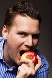 Diet nutrition. Happy man biting apple fruit Stock Photo
