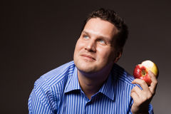 Diet nutrition. Happy man eating apple fruit Stock Photo