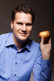 Diet nutrition. Happy man holding apple fruit Royalty Free Stock Images