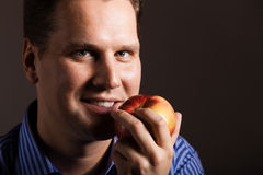 Diet nutrition. Happy man holding apple fruit Stock Image
