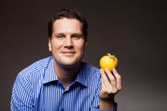 Diet nutrition. Happy man holding apple fruit Royalty Free Stock Photos