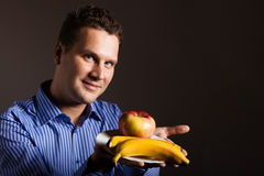 Diet nutrition. Happy young man holding fruits. Royalty Free Stock Photo