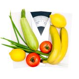 Vegetables and fruits on the scales Royalty Free Stock Photo