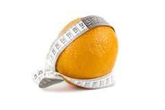 Diet. Orange with measuring tape isolated over white background Royalty Free Stock Images
