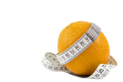 Diet. Orange with measuring tape isolated over white background Royalty Free Stock Photo
