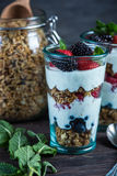 Diet parfait with granola and fresh fruit. In vintage masson jar Stock Photo