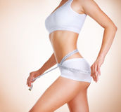 Diet. Perfect Slim Body. Woman measuring her waistline. Diet. Perfect Slim Body royalty free stock photo
