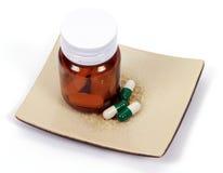 Diet pills. On a plate Stock Photos