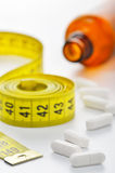 Diet pills and measuring tape Royalty Free Stock Photo