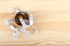 Diet pills with measuring tape Royalty Free Stock Photography