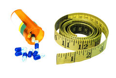 Diet Pills and Tape Measure Isolated Royalty Free Stock Images