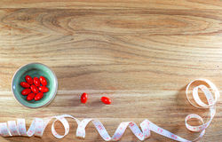 Diet pills on wooden background. Royalty Free Stock Photos