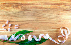 Diet pills on wooden background. Stock Photography