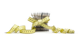 Diet pills with yellow tape measure Stock Photo