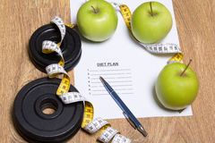 Diet plan concept - apples, measure tape and dumbbell Royalty Free Stock Image