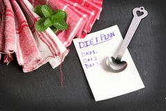 Diet plan. Concept shot showing paper chit with diet plan written on it Royalty Free Stock Photography