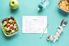 Diet Plan and Meals. Diet meal plan mockup with healthy food delivery. Fitness nutrition for diet. Daily meals on blue, top view, copy space stock photo