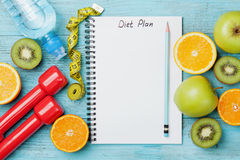 Diet plan, menu or program, tape measure, water, dumbbells and diet food of fresh fruits on blue background, detox concept Stock Images