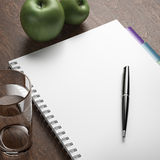 Diet plan with pen and apples. 3d render Royalty Free Stock Photos