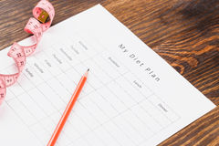 Diet plan, pencil and measuring tape Stock Image