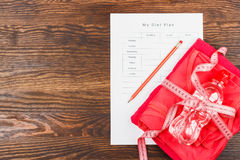 Diet plan, pencil and measuring tape Royalty Free Stock Photo