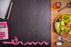Diet plan, tape measure, calculator for Count calories, salad royalty free stock photo