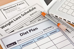 Diet Plan and Weightloss Schedule by Laptop. On Table Stock Photo