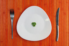 Diet plate of peas Stock Images