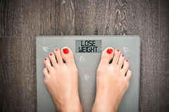 Diet problems concept with weight scale Royalty Free Stock Photo