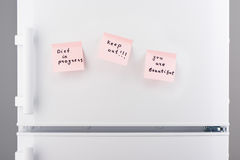 Diet in progress, keep out, you are beautiful notes on fridge Royalty Free Stock Photo