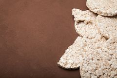 Diet rice cakes on brown background, copy space for text stock photography