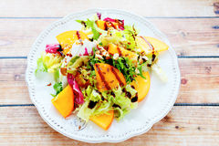 Diet salad with persimmon, top view Royalty Free Stock Photo