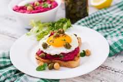 Diet sandwiches with beet root hummus, capers Stock Photos