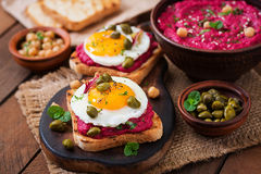 Diet sandwiches with beet root hummus, capers Stock Image