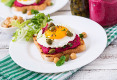 Diet sandwiches with beet root hummus, capers Royalty Free Stock Images