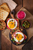 Diet sandwiches with beet root hummus, capers and egg. Royalty Free Stock Image