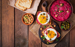 Diet sandwiches with beet root hummus, capers and egg. Royalty Free Stock Images