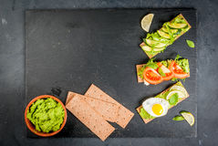 Diet sandwiches with guacamole and fresh vegetables. Healthy Eating, Diet sandwiches on gluten-free loaves - with guacamole, fresh vegetables tomato, cucumber Stock Images