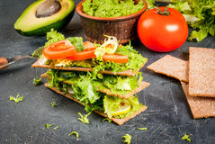 Diet sandwiches with guacamole and fresh vegetables. Healthy Eating, Diet sandwiches on gluten-free loaves - with guacamole, fresh vegetables tomato, cucumber Royalty Free Stock Photos